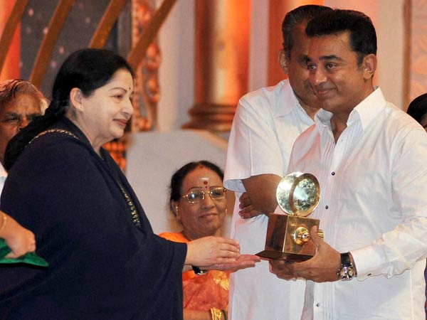 Jayalalithaa presenting an award to actor Kamal Hasan during the innaguration of the four-day Centenary Celebrations of Indian Cinema
