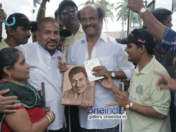 http://photos.filmibeat.com/tamil-events/super-star-rajinikanth-meets-blind-visually-challenged-people/47354.html