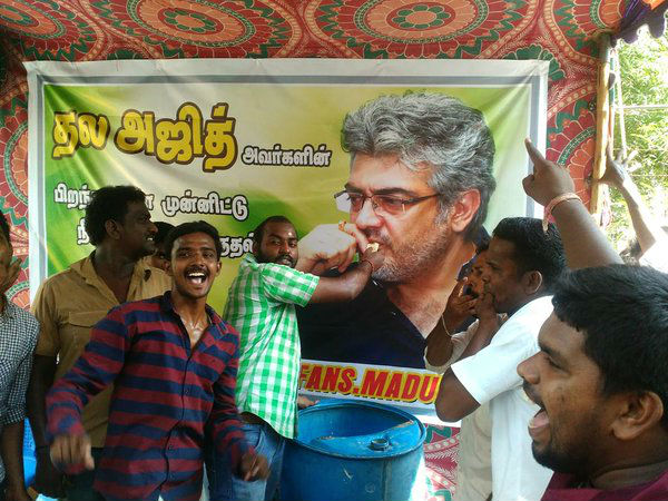 Fans feed cake to Ajith's banner