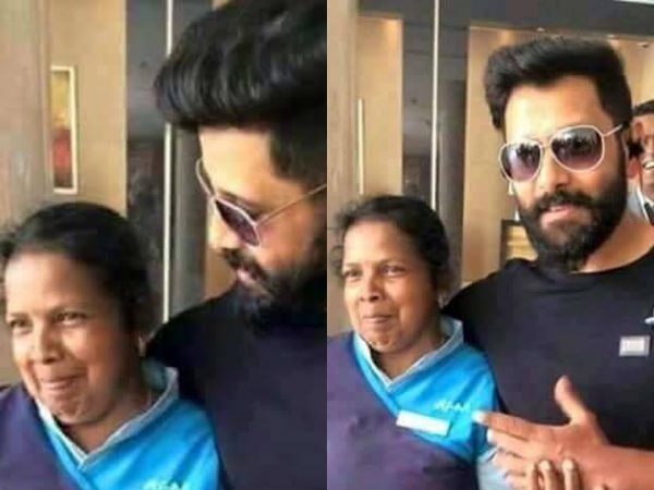Vikram takes pictures with a sanitary worker