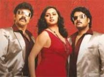 https://tamil.filmibeat.com/img/2009/07/10-hema-malini-200.jpg