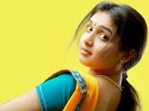 http://tamil.filmibeat.com/img/2011/12/23-moongil-vizhigal300.jpg