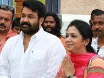 http://tamil.filmibeat.com/img/2013/05/15-poornima-with-mohan-lal-300.jpg