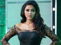 https://tamil.filmibeat.com/img/2018/10/amalapaul7487-1540374074.jpg
