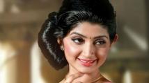 https://tamil.filmibeat.com/img/2020/03/divya-unni2-15775-1584330556.jpg