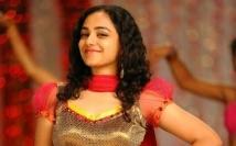 https://tamil.filmibeat.com/img/2020/07/nithya-menen5-1593765664.jpeg