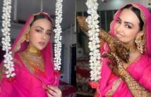 https://tamil.filmibeat.com/img/2020/11/newlywedsanakhansharesmorepicsfromherweddingalbum-1606371133.jpg