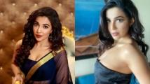 https://tamil.filmibeat.com/img/2021/05/parvathy-1622195905.jpg