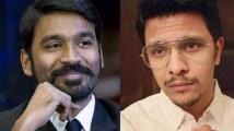 https://tamil.filmibeat.com/img/2021/07/karthidhanush1-1627456050.jpg