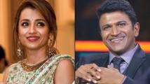 https://tamil.filmibeat.com/img/2021/08/trisha-puneethrajkumar-020821-1200x80011-1627974165.jpg