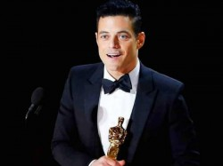 Rami Malek Falls From The Oscars Stage